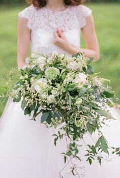 green and white bouquet - photo by Wedding Nature Photography http://ruffledblog.com/elegant-vineyard-wedding-inspiration #weddingbouquet #bouquets