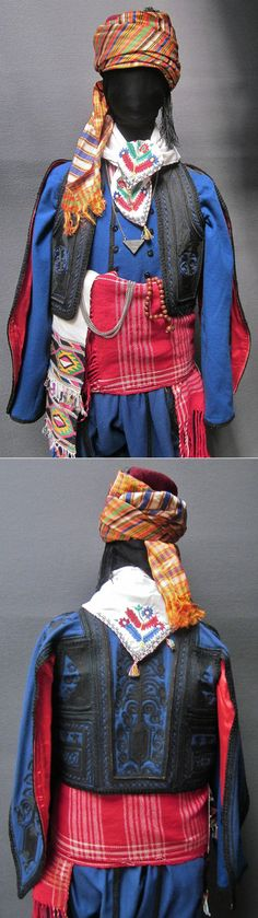 Close-ups of a traditional men's costume from the northern part of the Edirne province. Style: people's militia, c. 1900. The long-sleeved 'cebedan'/vest & 'kartal kanat'/outer vest (with hanging sleeves) are workshop-made machine-embroidered copies (1991), as worn by folk dance groups. The accessories are original (some of them old:1925-'60): woollen 'kuşak'/belt, woven or embroidered kerchiefs, silver chain, silk headscarf, felt hat.  (Kavak Folklor Ekibi&Costume…