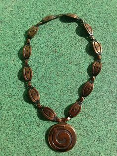 Check out this item in my Etsy shop https://www.etsy.com/listing/257533104/vintage-1940s-copper-necklace-deco