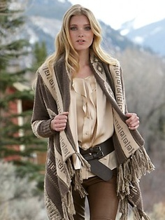 $998 heartbreaker poncho Gorsuch.com  • wool/cashmere  • knitted sleeves  • s/m, l/xl  • imported