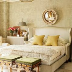 Love the curves and the arms on this one.  List of wingback headboards on Like Me Some Blog...