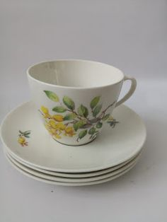 Locally manufactured set of four cups and saucers by Continental. Lovely yellow flower pattern which resemble wisteria. Cup And Saucer Set, Cape Town, Yellow Flowers, Flower Patterns, Skyscraper, Tea Cups, Retro, Tableware, Doodle Flowers