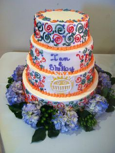 tye dye wedding cake with swirls and a boognish symbol