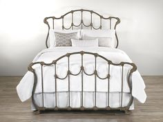 The Hamilton iron bed carries stately lines that indicate royal heritage, but its presence is one of well-established, superbly confident style. A shield-like head and footboard, carefully adorned with twisted metal that looks for all the world like fine wound rope or tassel, add to the iron bed's dignity, while details like an aged antique finish and whimsical claw feet add little touches to an otherwise imposing style.