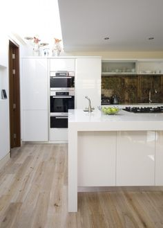 White oak floor with white gloss kitchen