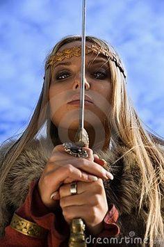 Viking girl warrior on a blue sky background by Dmitriy Cherevko, via Dreamstime: