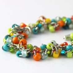 Tropical Cluster Bracelet - Colorful Teal Blue Turquoise Lime Green Orange Yellow Beaded Silver Tone Bracelet - Fun Multi Color Bracelet by productsof47 on Etsy https://www.etsy.com/listing/217734107/tropical-cluster-bracelet-colorful-teal