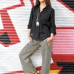 Anna Leychenko: CHAI Studio basic chemise in black $82, CHAI Studio 'Hatha' pants in polka dot $66, Wanderlust 'Dreamer' necklace $80