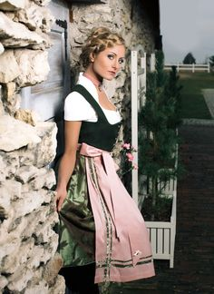 Dirndl -  Bavarian/Austrian Traditional Female Peasant Clothing during the 17th and 18th Centuries.  Later the Austrian upper classes adopted the dirndl as high fashion in the 1870s.