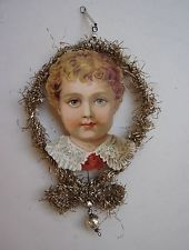 ANTIQUE PAPER BOY HEAD IN A TINSEL FRAME CHRISTMAS ORNAMENT
