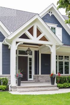 Nice Roof Lines with Covered Front Porch. Nice greyish blue house color with white trim.