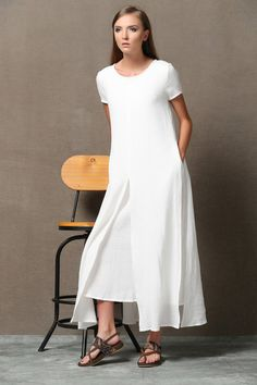 Super feminine and sophisticated, this soft white cotton linen dress is a must-have for any summer wardrobe. it is soft. Wear it with a pure silk stole to give it a classy look or chunky boho jewelry for a more casual look. Youll create an entrance wherever you go with this beautifully flowing linen dress. Flaunting a double layered design of soft linen, the dress is loose-fitting and suitable for plus size ladies. The dress has short sleeves and a round neck with 2 side pockets. You may…