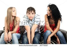 Two beautiful girls with a shy young man.
