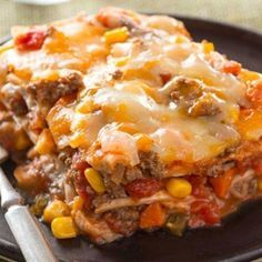 Ground beef, salsa refried beans and cheese are layered between tortillas for a burrito bake that's like a fiesta in a dish. 27 Comforting CasserolesThe 50 Best Burritos in AmericaNot Your Average Taco: 12 Tacos That Break Away From Tradition Burrito Bake Recipe, Burrito Casserole, Casserole Recipes, Refried Beans Casserole Recipe, Reuben Casserole, Mexican Casserole, Cabbage Casserole, Hamburger Casserole, Chicken Casserole