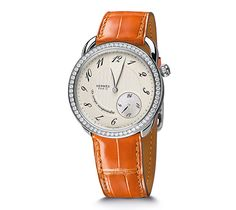 "Arceau Hermes steel watch set with diamonds, diameter 38mm, opaline silvered dial,  automatic movement, ""suspended time"" module, short interchangeable smooth red agate alligator leather strap"