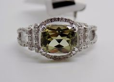 2.4 Ct Antique Cut Zultanite® &. 30 Ct. Diamond Ring 14k Solid Gold NWT RA01725. It features a rare, natural, ethically mined and color changing Zultanite that measures 9x7mm in an antique cushion cut that weighs 2.4 carats.
