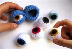 inspiration: Double Monster Eyes - Ok it's not a skull, but it belongs in one.-Double Monster Eyes - just the pic. The actual site sells em forDouble Monster Eyes -- Pin it to hats, shoes, scarves, etc.Double Monster Eyes: maybe Grandma could help us Crochet Eyes, Knit Or Crochet, Cute Crochet, Crochet Crafts, Yarn Crafts, Crochet Stitches, Crochet Projects, Crochet Amigurumi, Amigurumi Patterns