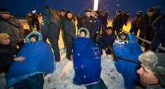 Expedition 33 Commander Sunita Williams of NASA, right, and Flight Engineers Yuri Malenchenko of ROSCOSMOS (Russian Federal Space Agency), and Akihiko Hoshide of JAXA (Japan Aerospace Exploration Agency), left, sit in chairs outside the Soyuz Capsule just minutes after they landed in a remote area outside the town of Arkalyk, Kazakhstan, on Monday, Nov. 19, 2012. Expedition 33 Soyuz Landing (201211190010HQ)