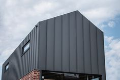 Amess Street features COLORBOND® Matt Steel Basalt® in a Standing Seam cladding roof and wall panel system by Metal Cladding Systems Cladding Design, Cladding Systems, Colorbond Roof, Steel Cladding, External Cladding, Cladding Materials, Street House, Shed Homes, House Paint Exterior