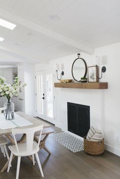 Get Inspired: The DIY White Brick Fireplace (Love this one in a Dining Room!) It's time to get inspired by these white brick fireplaces! A white fireplace will help to brighten a room and will give the fireplace a more modern feel. My Living Room, Home And Living, Living Spaces, Style At Home, Sweet Home, Home And Deco, Home Interior, Interiores Design, Home Design