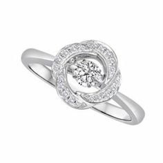 How amazing is this 'Rhythm of Love' with a round-cut, floating diamond center stone?! PIN if you'd wear it! #RhythmofLove #MUSTHAVE #jimsjewelers