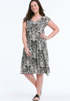 "Paisley print knit t-shirt dress has A-line shape and V-neckline. Dolman cap sleeves. Straight bottom hem.Fabric:100% rayonMachine washImportedMeasurementsLength: Mid knee40"", center back"