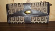 NICE! HIGH FASHION,FENDI WALLET! RETAILS $180/200,THIS IS NWOT,SZ.6X8 APPROX. GREAT DESIGN& STYLE!!: http://www.outbid.com/auctions/10348-fashion-s-first-retro-retail-groovy-gadgets-express-your-innerself-jewelry#52