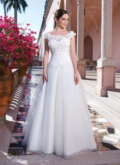 Sweetheart Gowns sweetheart style 6077 Tulle, corded embroidered beaded lace ball gown emphasized by a sweetheart neckline.