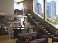 Urban apartment with loft and brick wall.