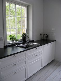 Stylish black and white IKEA METOD LAXARBY kitchen on JenkaHouse