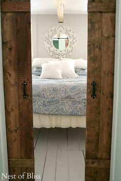 Love this peek through barn doors into a cozy country bedroom.DIY Sliding Doors - Nest of Bliss Guest Bedrooms, Beautiful Bedrooms, Home Projects, Home Hacks, Diy Sliding Door, Living Space Decor, Home Remodeling, Bedroom Diy, Home Decor