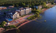 Beachfront hotel situated on East Grand Traverse Bay with indoor and outdoor pools, hot tubs, and spacious waterfront suites and studios