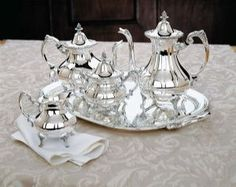 Vintage inspirations create Reed and Barton's Burgundy tea set. Silver plated, the tea service is readily tailored by staffed engravers from Silver Gallery. Coffee Type, Coffee Set, Chinese Tea Cups, Silver Tea Set, China Tea Sets, Tea Cup Set, Reed & Barton, Tea Service, Tea Pots