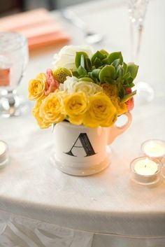 Where can we find monogrammed cups for centerpieces and what are we going to do with them after the wedding?
