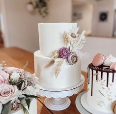 A minimal white two tier cake and dried florals is a sweet choice for a low-key rustic wedding. See more rustic wedding cake, decor, and dress ideas at rusticweddingchic.com 📸: @ferknot_pop_up_weddings 🍰: @sugarandbloomcakes Wedding Cake Rustic, Wedding Cakes, Boho Cake, Chocolate Drip Cake, Two Tier Cake, Modern Cakes, Wedding Cake Inspiration, Wedding Ideas, Take The Cake