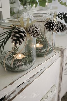 Christmas decor: Votives in a simple mason jar with twin and pine cones and candle. Gorgeous and simple!