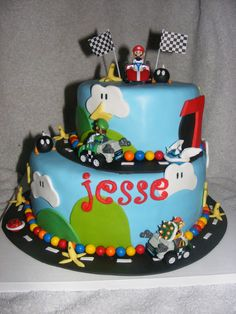 Mario Kart for Jesse! - WASC cake with SMBC. All edible, except karts and flags. Unfortunately, the pre-made letters of his name were attacked by my toddler, so these were very fresh fondant letters added minutes before delivery... all in all, still happy with the result!