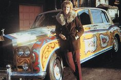 A fan poses with John Lennon's colorful Rolls-Royce in the #1960s #Beatlemania