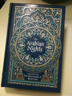 Arabian Nights book w/ ornaments