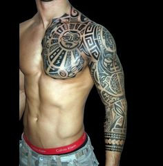 Cool Looking Chest, Shoulder And Arm Tribal Tattoo.