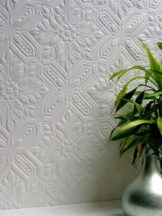This beautiful floral textured wallpaper mimics the look of antique tin ceiling tiles.   AmericanBlinds.com