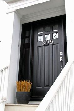 Make a statement with sleek mid-century modern numbers and a contemporary handleset against a black door. #AdoreYourDoors