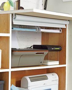 Paper trays mounted underneath shelf