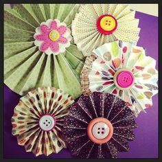 Making #paper pinwheels :) perfect for #cupcake toppers or decorations! #gluegun #buttons