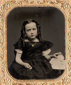 Adorable sixth-plate tintype of a cute young girl posed with her lion statue.  The lion appears at rest or possibly dying as it appears to be quite emaciated and its ribs are visible.
