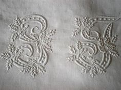 Embroidered initials - white on white, are classic, and classy, adding a touch of old world elegance to bed linens and dining table.
