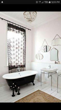 multiple mirrors on wall, contrast tub