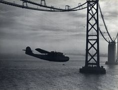 The Clippers opened up the exotic locations of the Far East to manageable, timely access, compared to ships.  Photographer Clyde Sunderland took several aerial shots of the Clippers flying over the Bay Area, including the iconic shot of the China Clipper flying under the partly constructed Bay Bridge on its inaugural flight.  Sunderland forged close relationships with many aviators while working as an engineer and Naval Reserve officer at the Oakland airport, and it was through his…