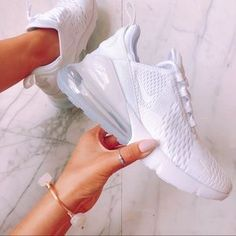 AIR MAX 270 All White.Step forward in a fresh silhouette that pays homage to two Nike Air Max classics with a pair of Air Max 270 shoes. The result is the tallest-ever Max Air heel unit, clocking White Nike Shoes, Nike Air Shoes, Nike Tennis Shoes, Nike White Trainers, Cute Sneakers, Girls Sneakers, Sneakers Fashion, Nike Air Max, Balenciaga