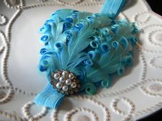 bridesmaids will be wearing these in their hair, just on a hairclip, not a headband. perfect color and definitely got that old hollywood glam feel. just ordered them!